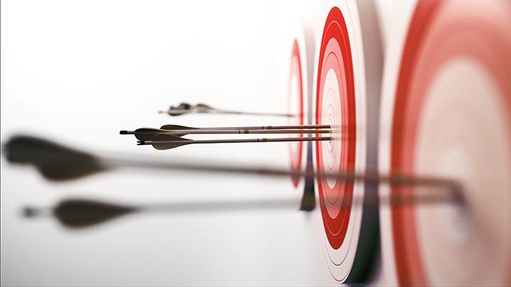 close up of arrow in bullseye