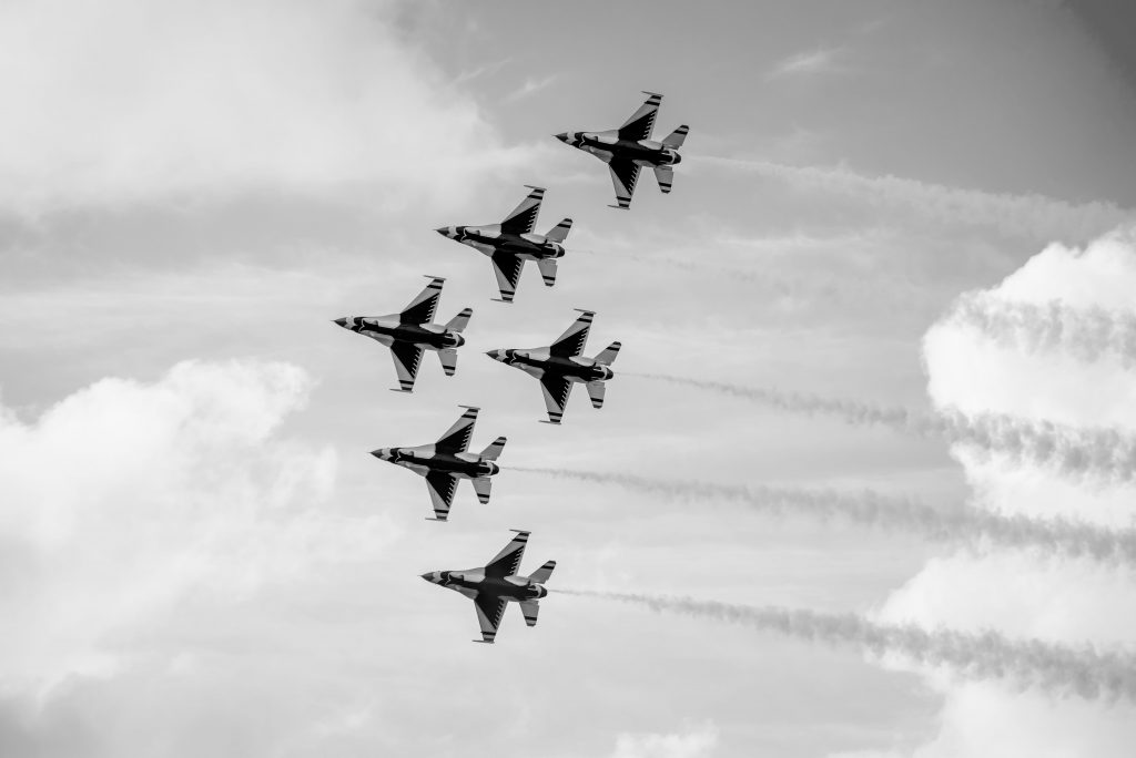 6 military planes flying